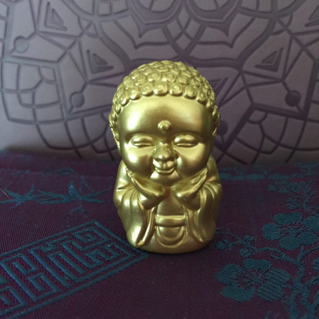 happy buddha against lavender and purple background