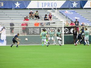 Connor Tobin nods home the first goal of the match.